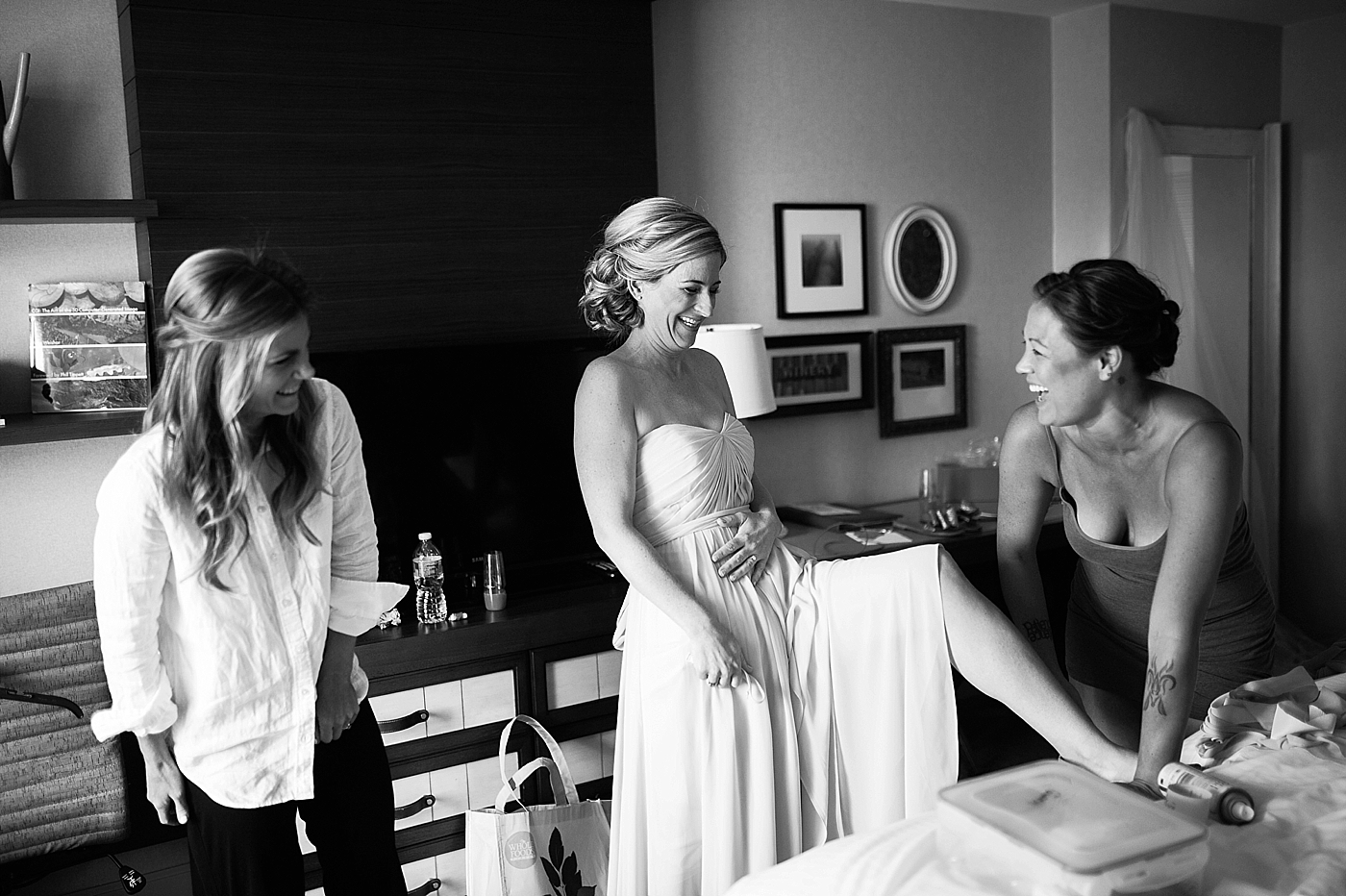 bridesmaids laughing while getting ready