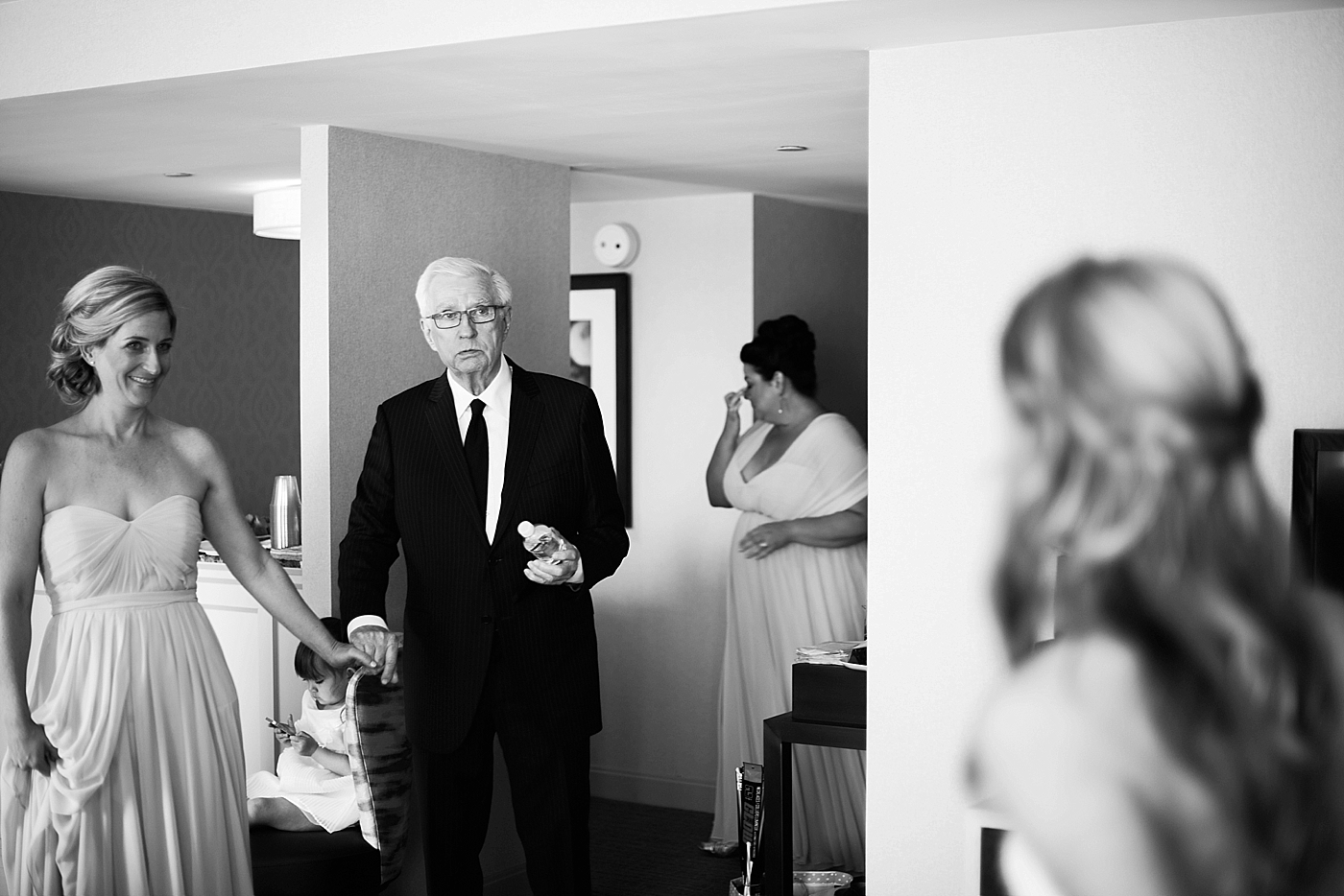 father tearing up over bride