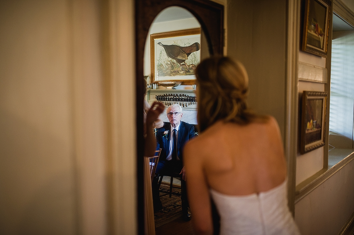 father watching daughter get ready