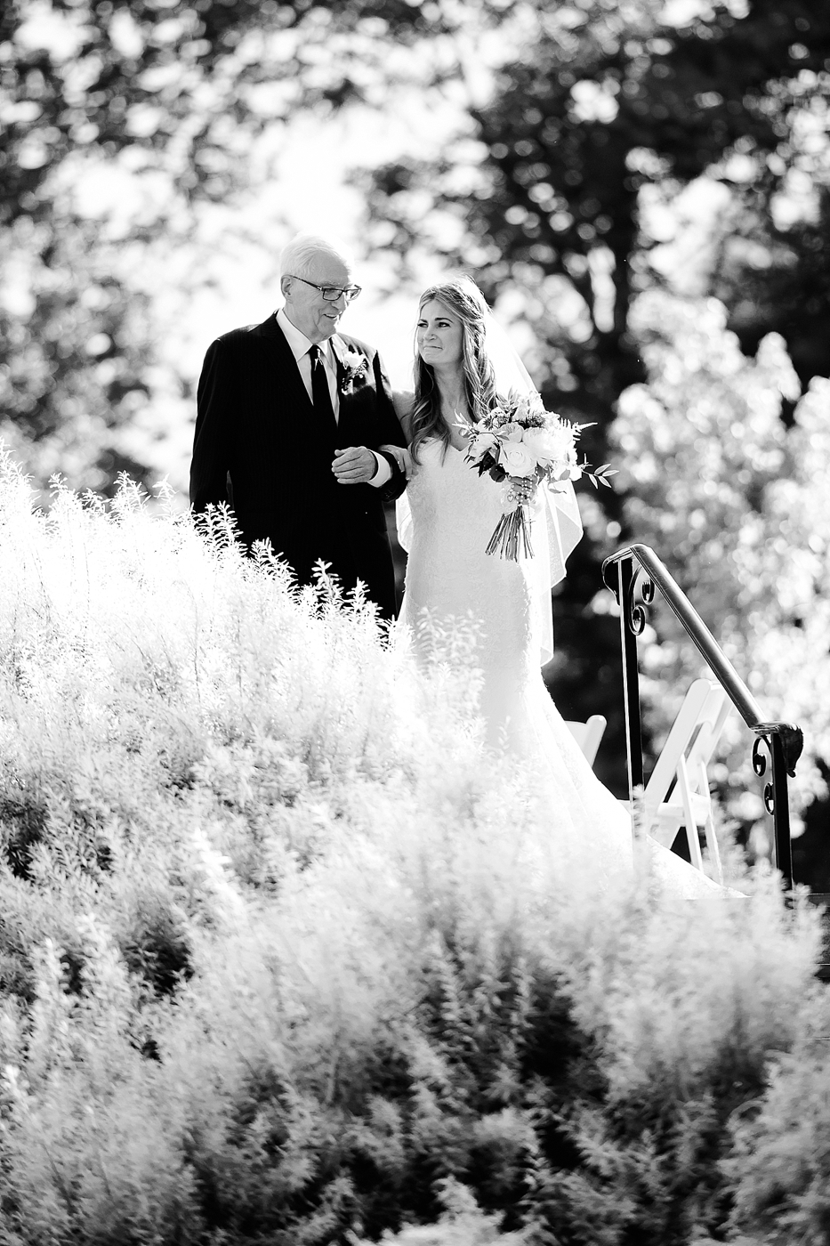 emotional bride walking with dad