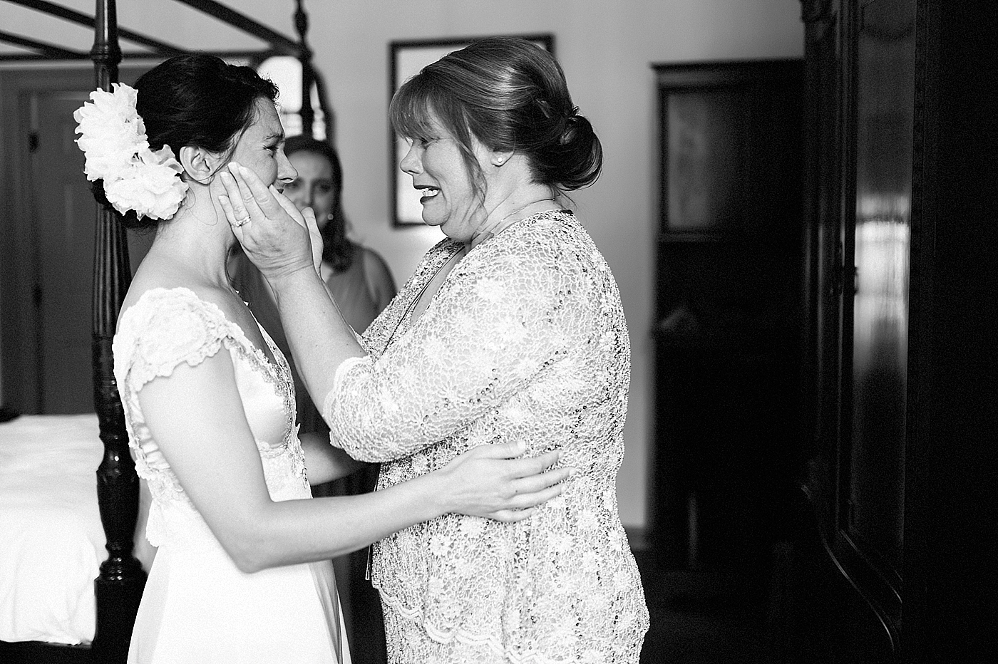 emotional moment between bride and mom
